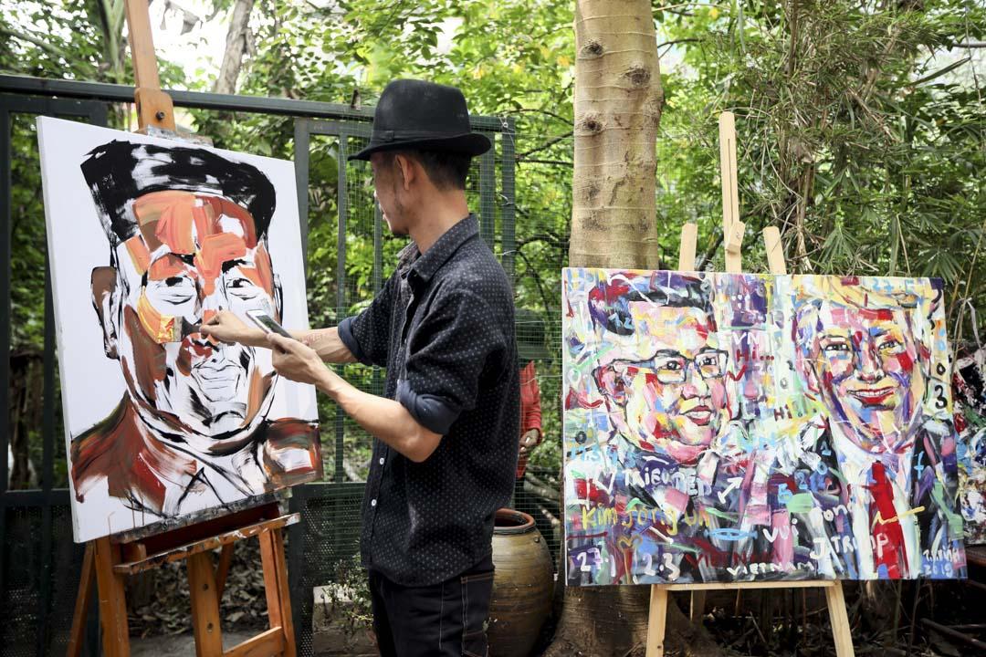 2019年2月21日,越南河內的藝術家Tran Lam Binh創作特朗普和金正恩肖像畫,迎接即將到來的第二美朝首腦會晤。