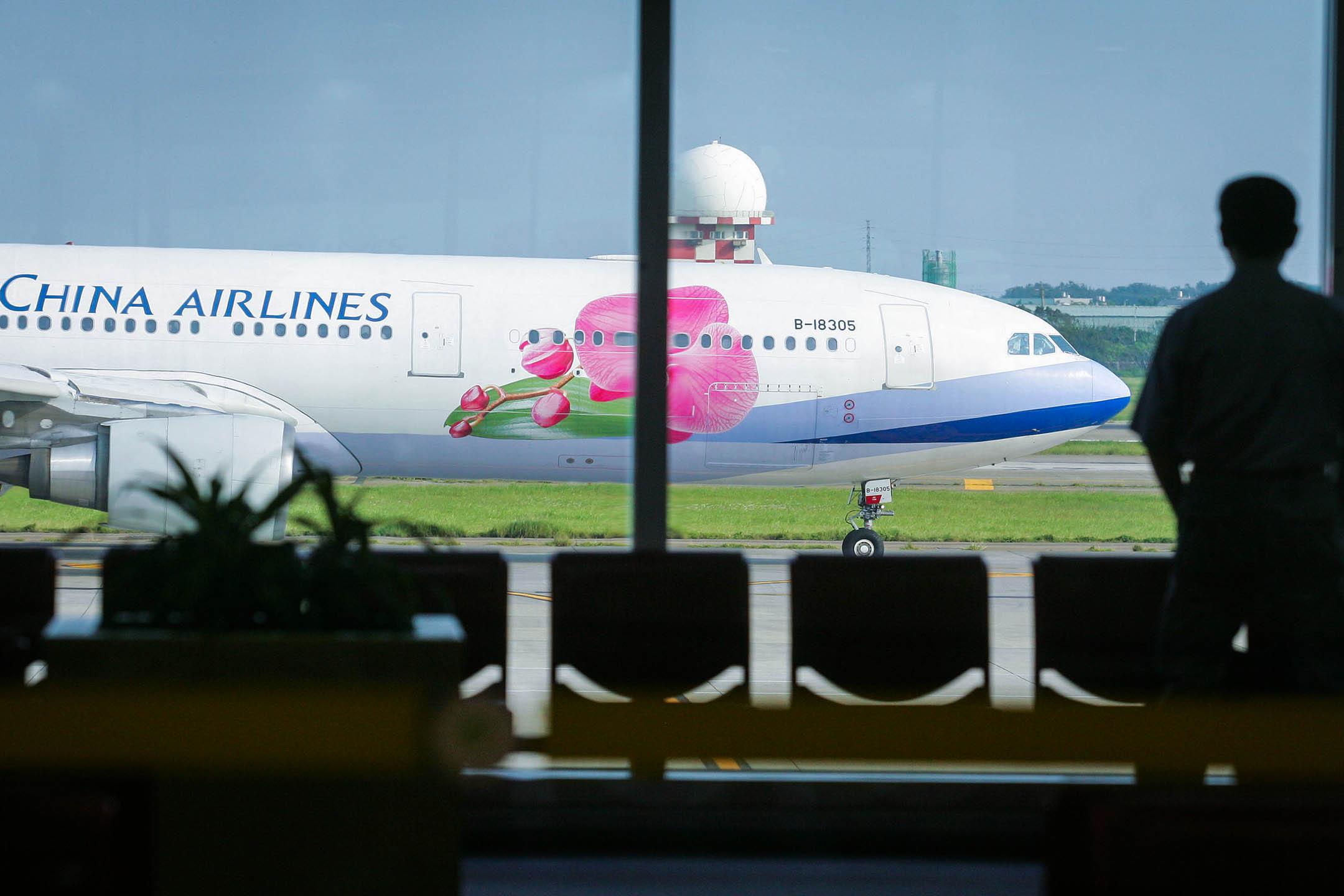 桃園國際機場的中華航空飛機。 攝:Maurice Tsai/Bloomberg via Getty Images