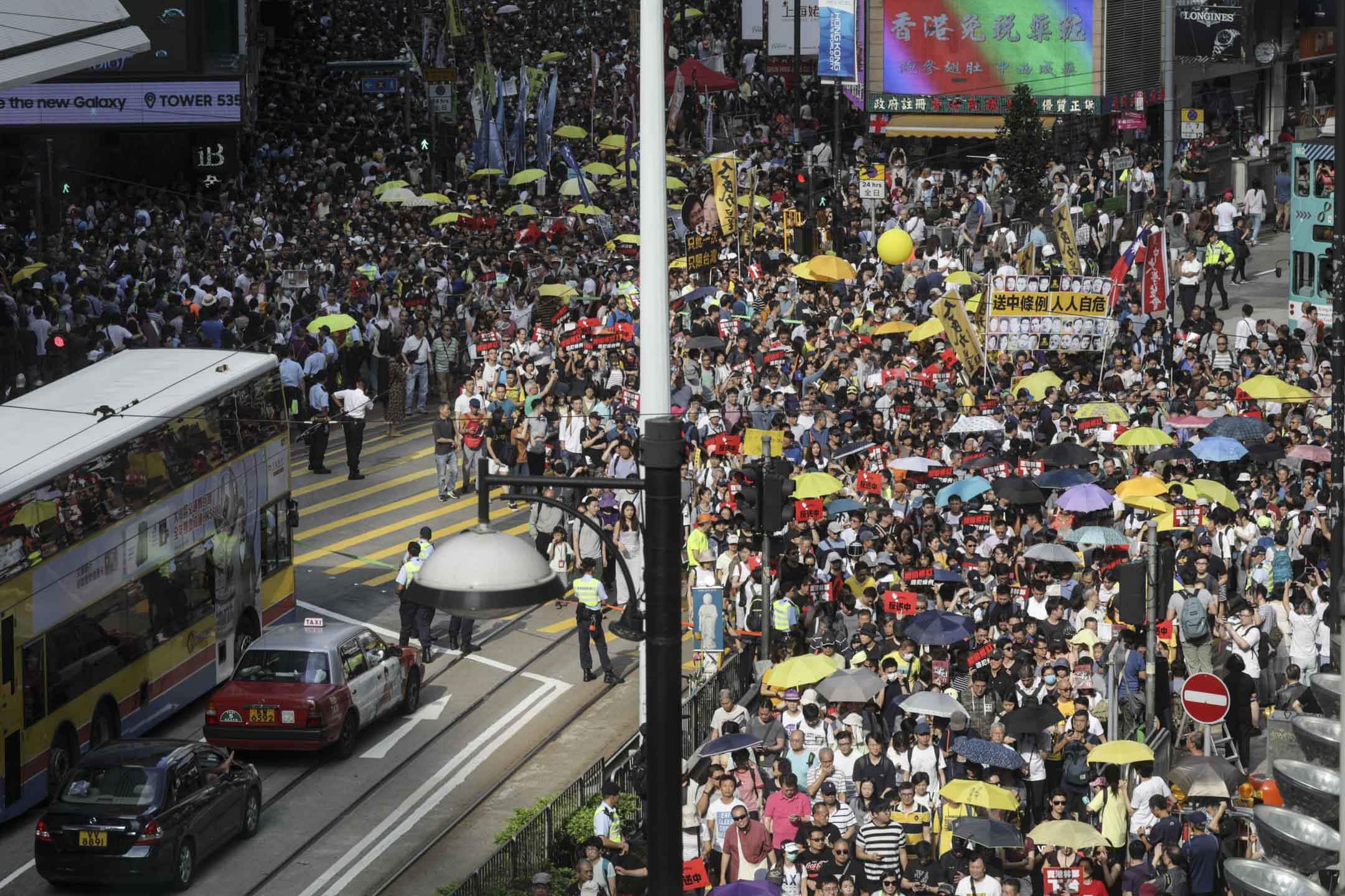 2019年4月28日,民間人權陣線舉行反《逃犯條例》修訂大遊行,隊伍由銅鑼灣東角道出發,將遊行至立法會外進行集會。 攝:Stanley Leung/端傳媒