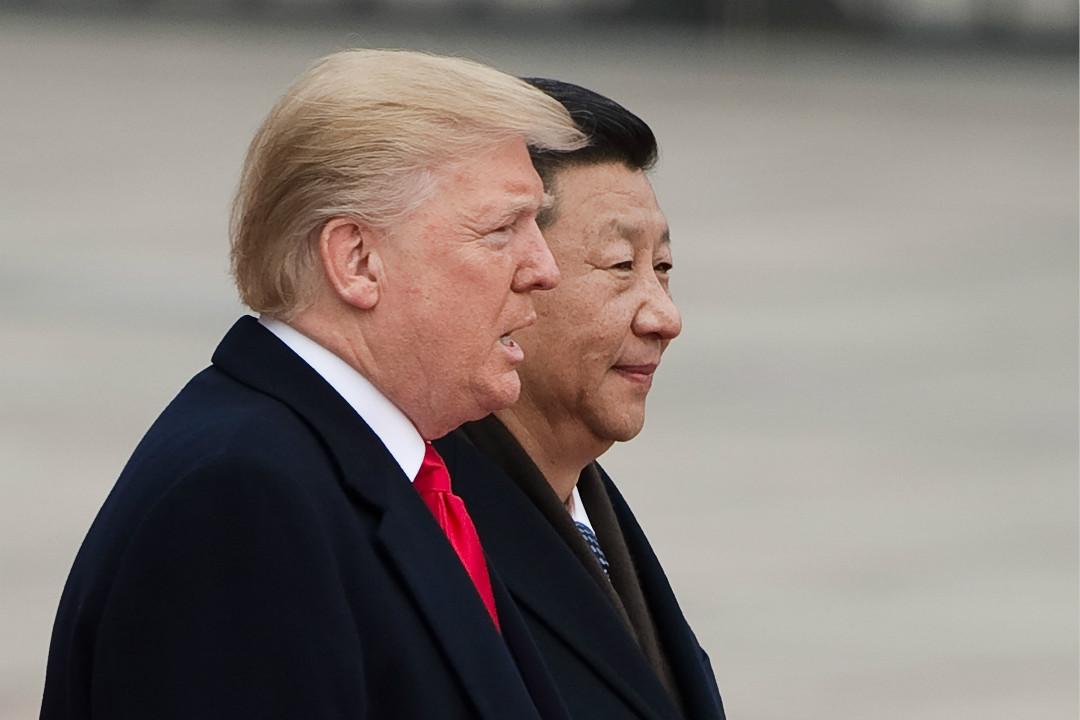 2017年11月9日,特朗普訪問中國,與習近平在北京長城參加歡迎儀式。 攝:Nicolas Asfouri/Getty Images