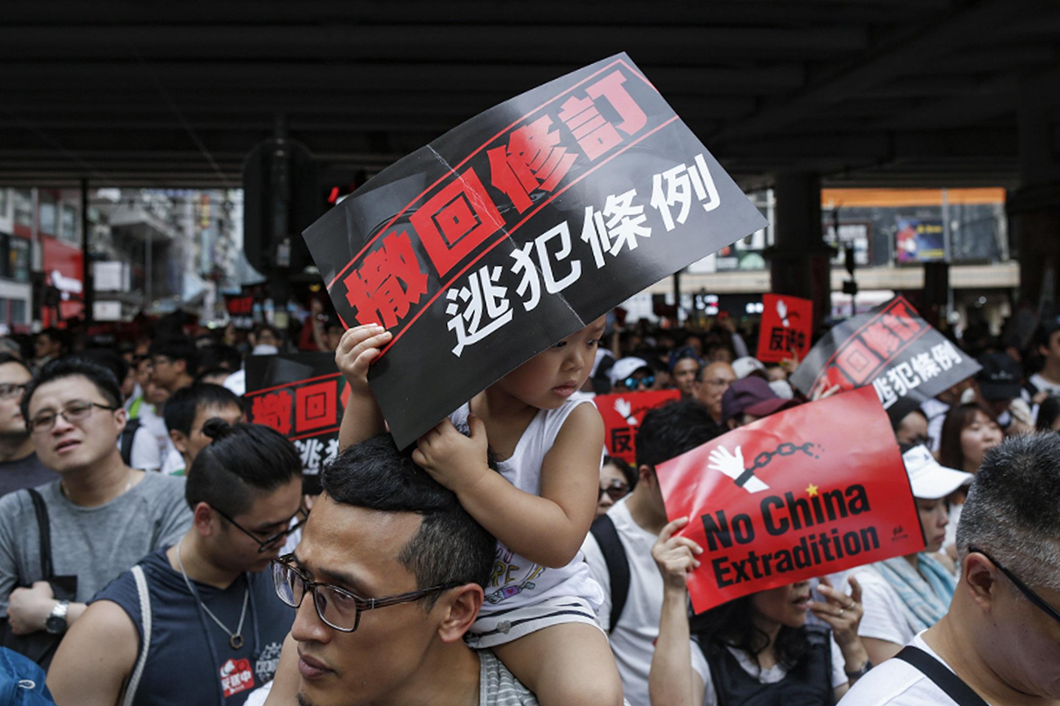 2019年6月9日,民間人權陣線發起「反送中」遊行,有遊行人士帶同孩子來參加。