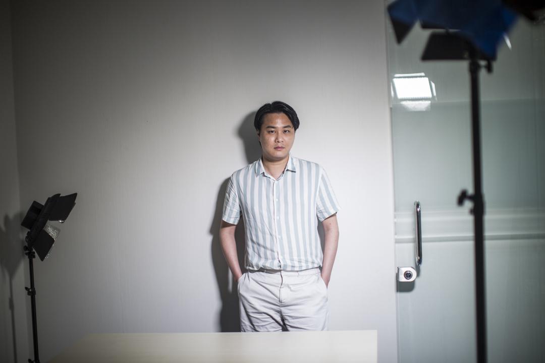 今年41歲的袁彌昌是研究戰略理論的學者,過去幾年以「中間派」姿態在不同政治團體效力,過去兩年半在新民黨及匯賢智庫,分別擔任政策總裁及政策顧問。 攝:林振東/端傳媒
