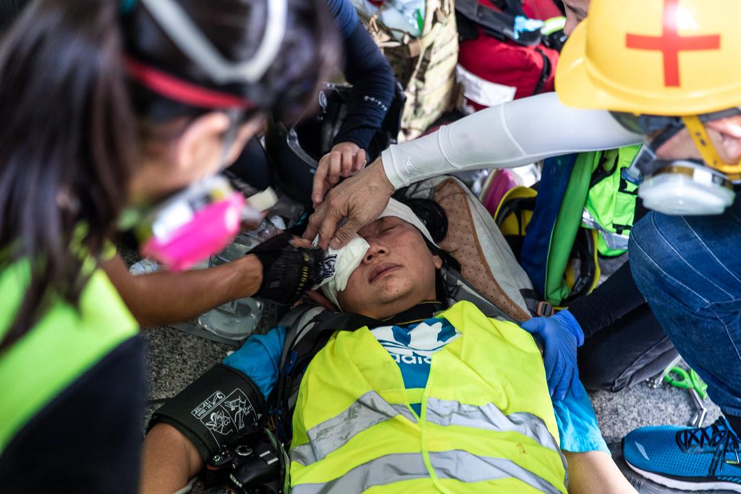 2019年9月29日,「全球反極權」大遊行期間有記者眼部中彈。