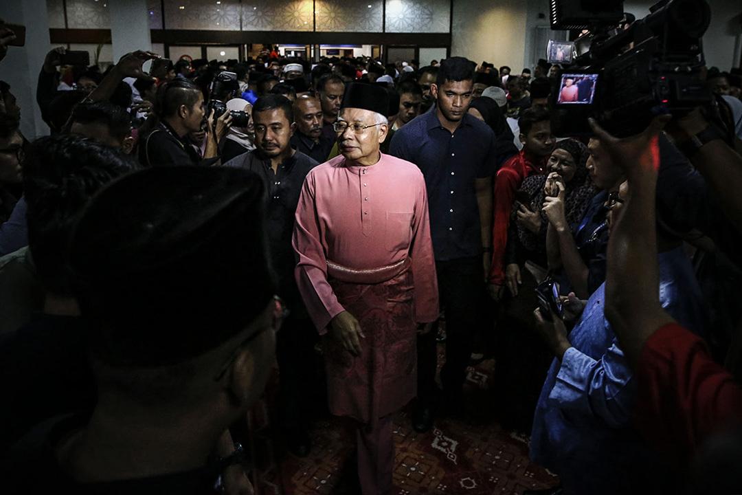馬來西亞前總理納吉布·拉扎克在2018年5月11日馬來西亞吉隆坡舉行的巫統72週年慶典前祈禱。