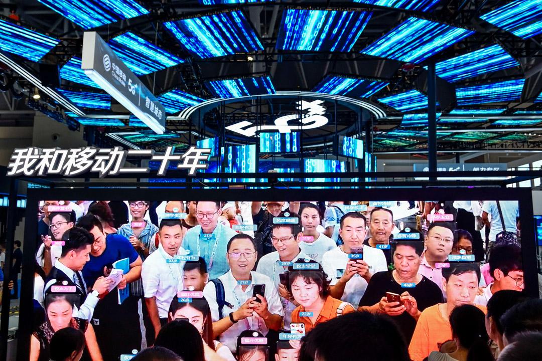 2019年8月,中國移動在重慶的中國國際智能產業博覽會展示人臉識別科技。 攝:Visual China Group via Getty Images