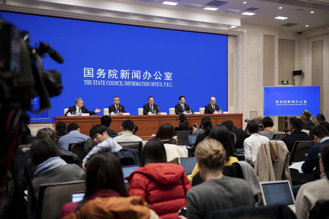 2019年12月9日,中國國務院新聞辦公室就新疆情況召開記者會。 攝:Nicolas Asfour / AFP via Getty Images