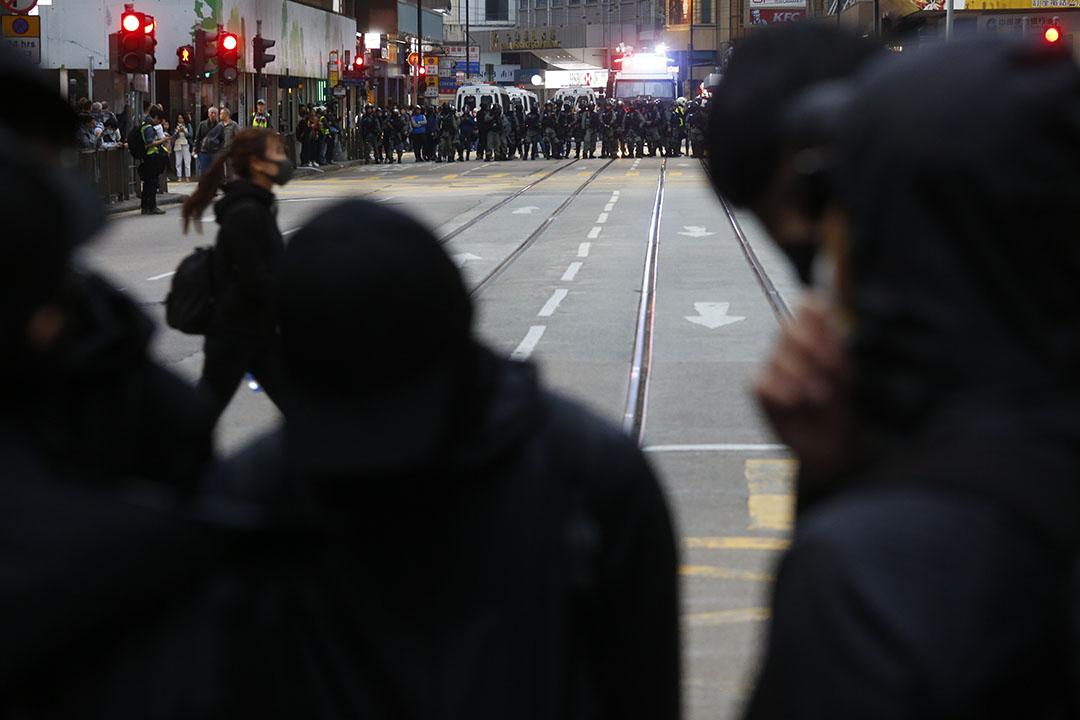 2019年12月8日,民陣發起國際人權日遊行,遠處的警察出動水炮車。