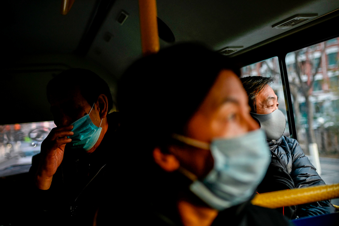 2020年1月21日,北京公交上不少的乘客均戴上口罩。