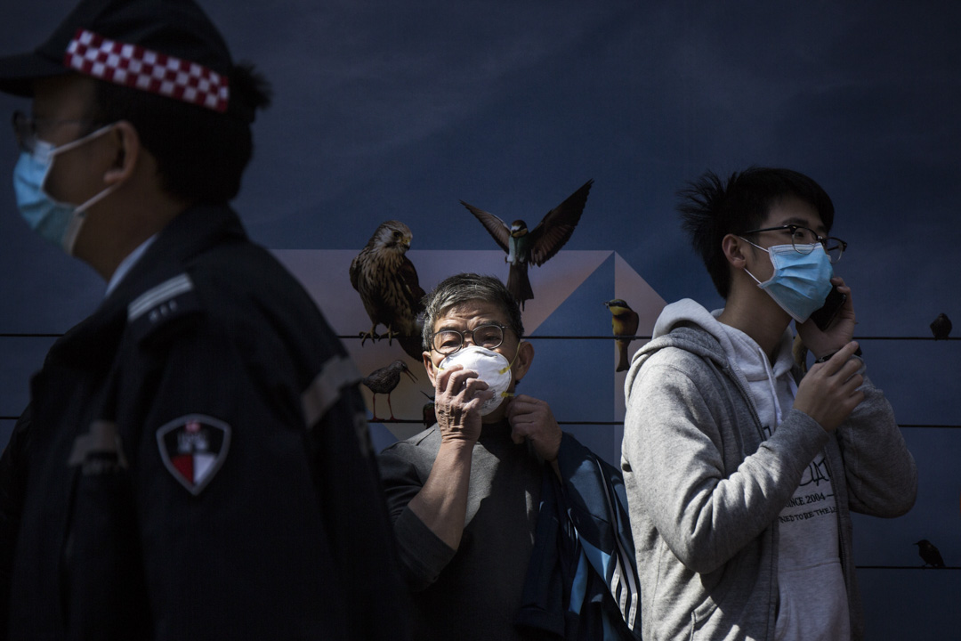 2020年1月31日,香港市區戴上口罩的市民。 攝:陳焯煇/端傳媒