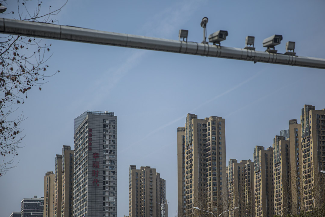 百步亭社區一高層建築上寫着『統建百步亭,幸福時代』的標語。