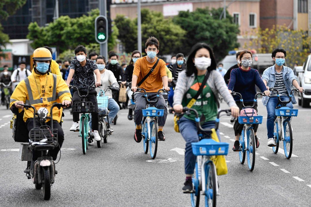 2020年3月26日,中國多個城市陸續恢復工作。圖為廣州。 攝:Getty Images