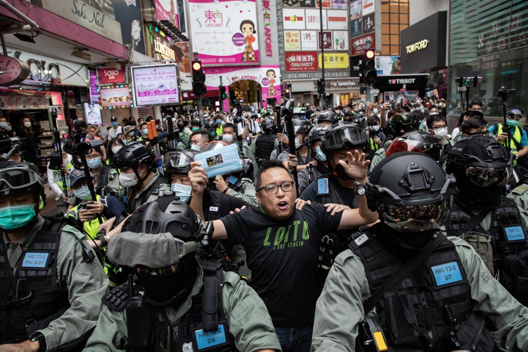 2020年5月24日,市民在香港島一帶發起反對國安法及國歌法遊行,人民力量副主席譚得志被捕。
