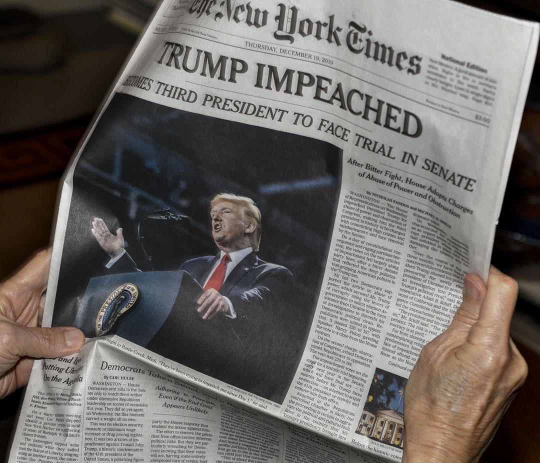 2019年12月23日,《紐約時報》以美國總统特朗普作為頭條新聞。 攝:Robert Alexander/Getty Image