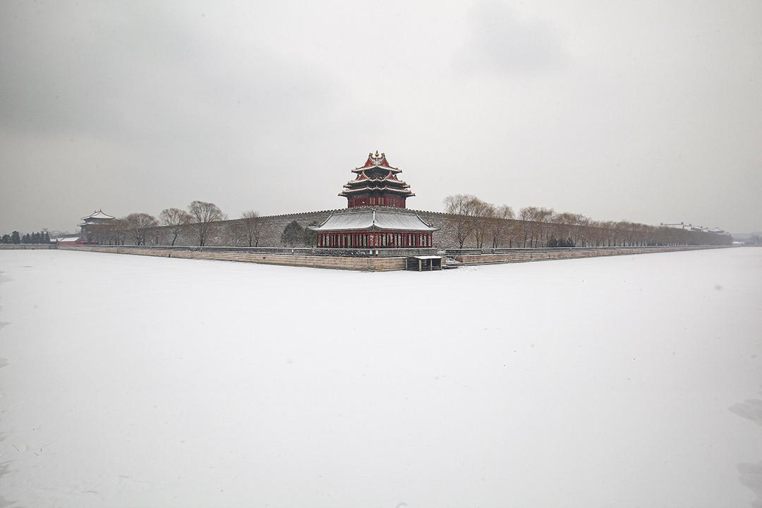 2011年2月10日北京,積雪下故宮的城樓。  攝:Feng Li/Getty Images