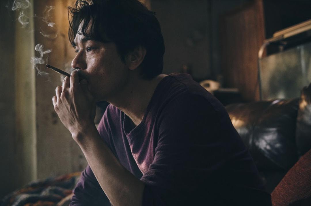 《手捲煙》電影劇照。