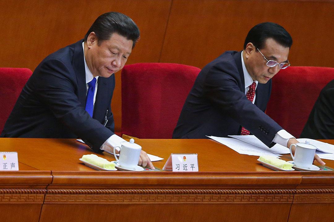 2015年3月15日北京中國人民大會堂,中國國家主席習近平(左)和李克強總理(右)在會內進行表決。