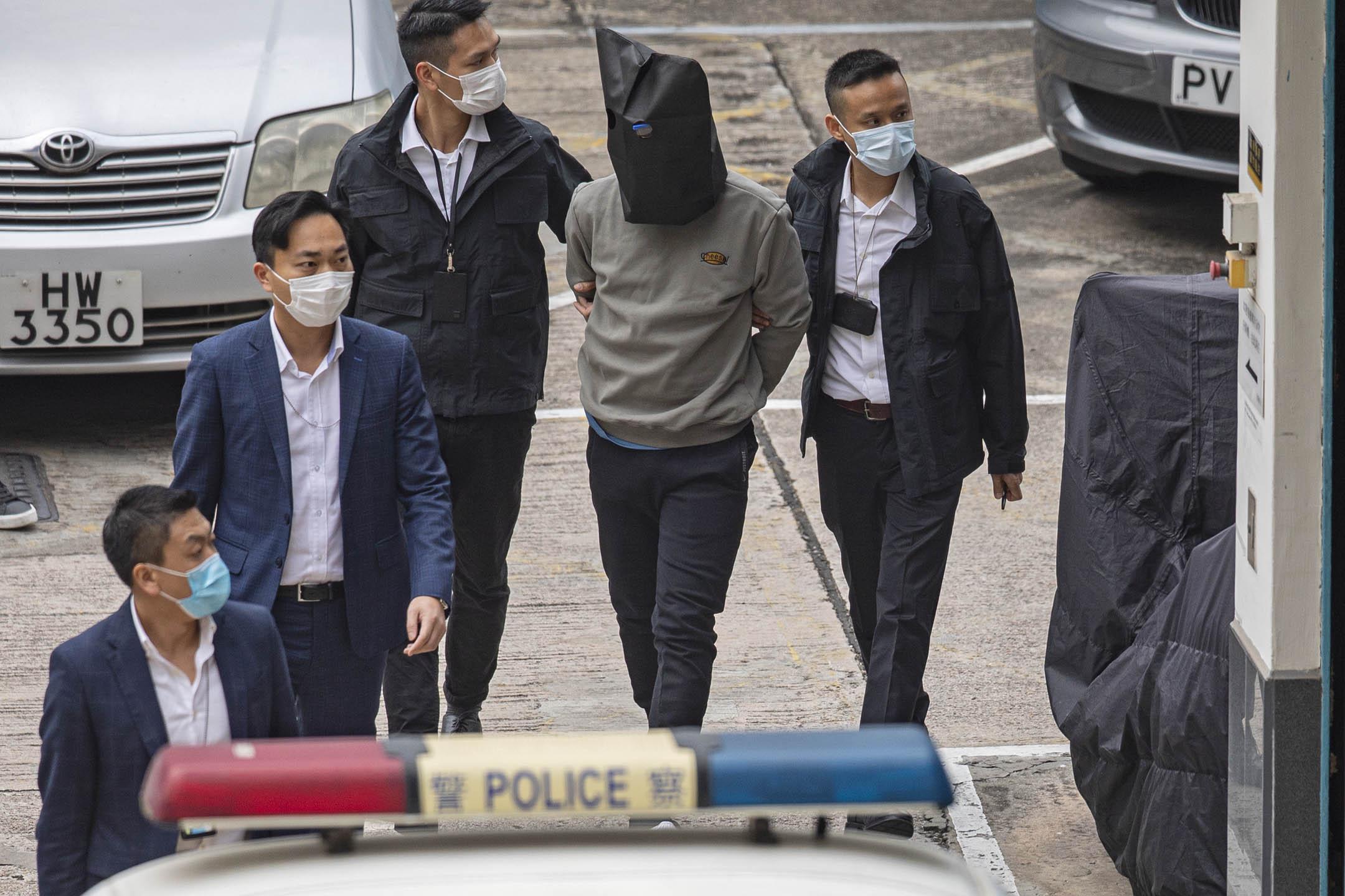 2021年3月22日,「12港人案」其中八人在中國服滿刑期,由中國當局分批經深圳灣口岸移交香港警方。 攝:陳焯煇 / 端傳媒