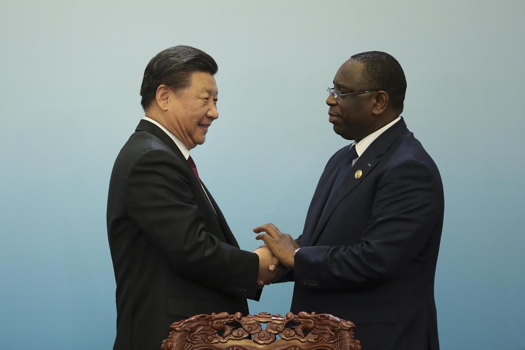 2018年在9月4日,國家主席習近平與塞內加爾總統麥基·索爾在中非合作論壇北京峰會上握手。