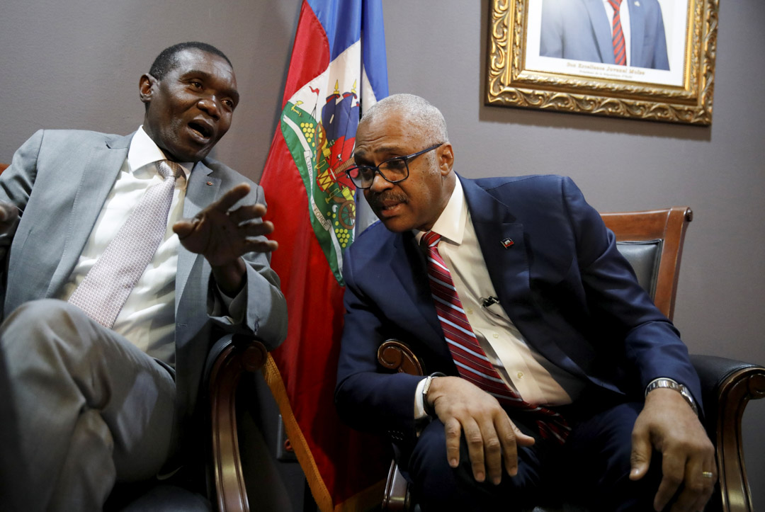 2018年7月11日,海地上議院的議長蘭巴特(Joseph Lambert)和總理傑克蓋伊拉方丹於在海地太子港舉行的新聞發布會上發表講話。