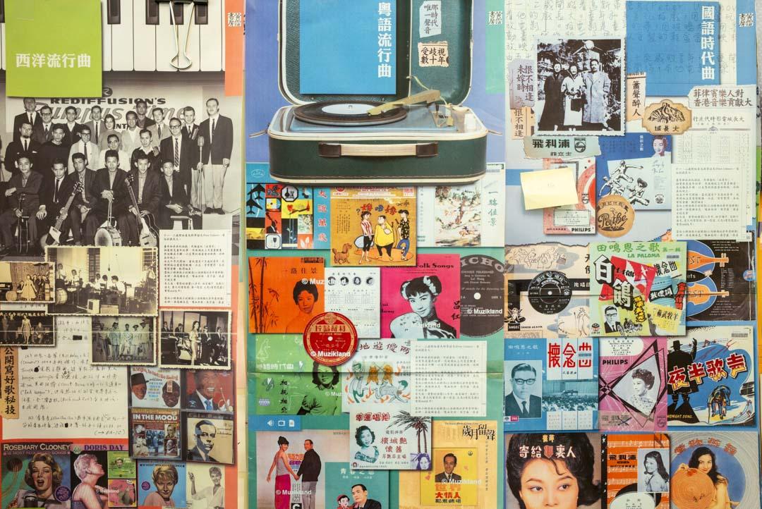 吳俊雄的辦公室仍留下當年製作時「黃霑書房」網站時的併貼海報。